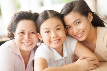 Grandmother, mother, and granddaughter smiling | Dentist Paddington NSW